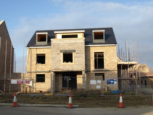 The shell of one of the houses under construction on the Loves Farm site, St Neots, in September 2008
