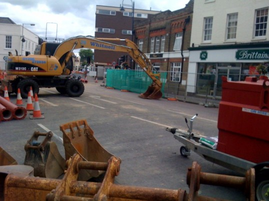 Roadworks on St Neots High Street showing the diggers about to start work in July 2009
