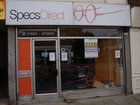 Specs Direct shop in St Neots High Street looking derelict, after closing down and going into liquidation, in October 2009