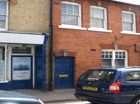 Norwich & Peterborough Building Society, 1 High Street, - blue side door in May 2010, formerly FHW Shoe shop.