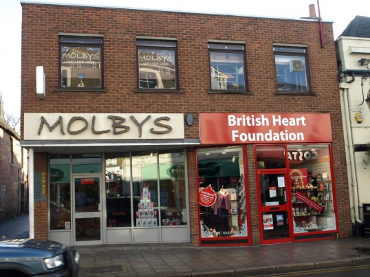 Molbys Hairdressers, and The British Heart Foundation Charity Shop in November 2008 St Neots High Street in November 2008