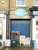 St Neots Chiropractic Clinic with Fishers shop hardware outside, on the south side of St Neots Market Square in November 2008