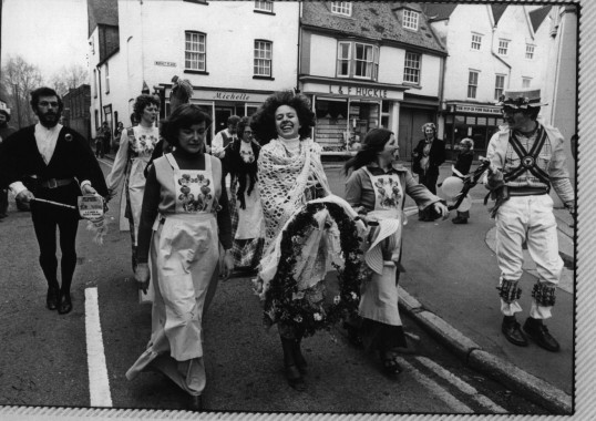 Heartsease ladies accompanied by the Folk Club dance their way around local inns in St Neots on Mayday in 1978.