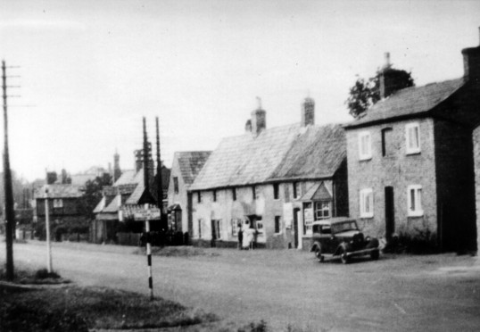 Great North Rd, Eaton Socon, showing Nelly Bull's sweet shop in the 1920's
