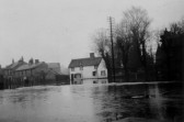 Looking across Eaton Ford Green during the flooding in 1947 with the Rose and Crown Public House