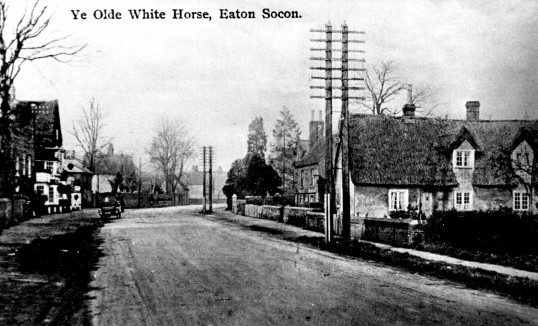 Looking north on the Great North Road with the White Horse on the left, Eaton Socon, in the 1930s