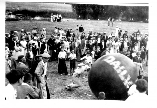 Pushing the Daily Mail Ball at Castle Hills, School Lane, Eaton Socon in the village gala day in the 1930s
