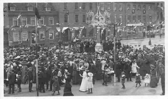 St Neots Market Square,  possibly an open air religious service with band on platform. Coronation Day 1911