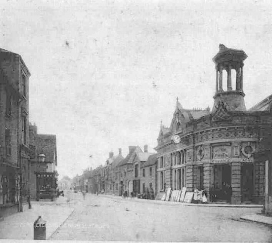 High Street, St Neots - view of the south side with the Corn Exchange in the foreground, dated 1892.