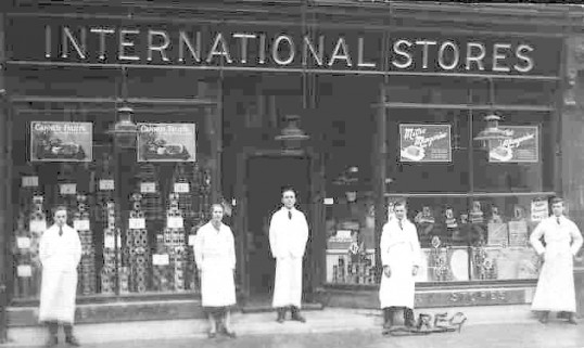 International Stores, High Street, St Neots, staff outside, dated 1920 - 1930.