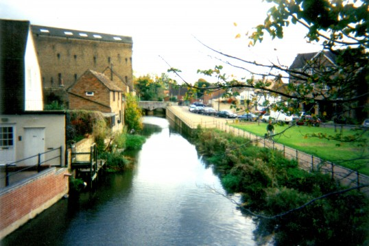 View along Hen Brook wharf, with industrial buildings in St Neots on the left and Navigation Wharf in Eynesbury on the right, about 2000
