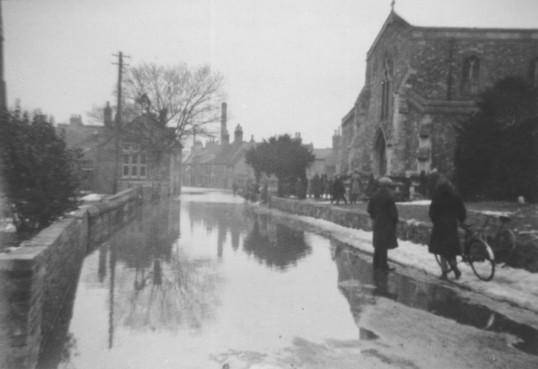 Eynesbury - Flooding in Montagu Street in 1947 with Eynesbury Church on the right