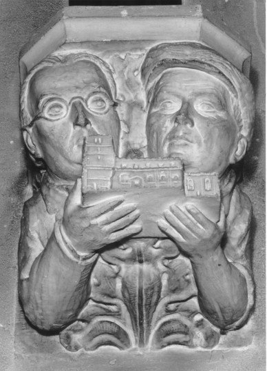 Eaton Socon Church - 1930s sculpture in the church showing the architect and builder involved in rebuilding the church after the 1930 fire