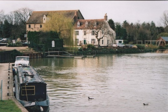 View of Eaton Socon Rivermill Tavern and Mill Cottage from the weir, in 2007