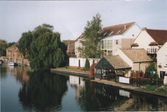 View of Bridge House Public house, dwellings and the Priory Centre looking north from the town bridge, in 2007