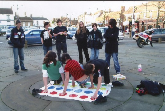 Playing Twister on the Sundial on the Market Square, St Neots, in 2007