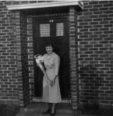 Jacqueline Scales getting the key to the door at 52 Queens Gardens, Eaton Socon, in 1954