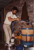 Using a wine press for making wine at home in Eaton Socon, about 1980