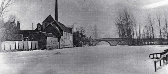 Frozen River Great Ouse in St Neots looking towards the River Bridge in 1898 - on the left are the St Neots Brewery buildings