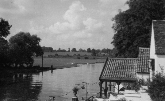 View looking north from the river bridge in St Neots in the mid 1960s, with The Bridge Hotel on the right and Regatta Meadow on the left