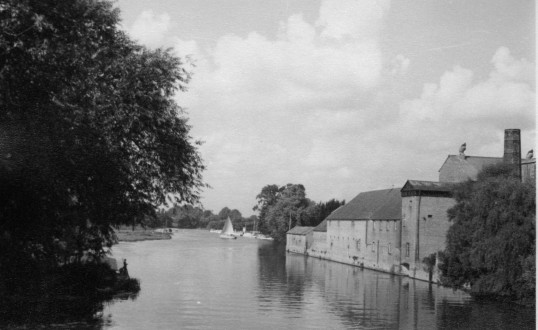 View from the St Neots River Bridge looking north with the former brewery buildings on the right in the mid 1960s