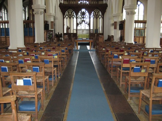 Eaton Socon Church, St Marys - view of the nave in June 2008 showing the cane work chairs bought for the church after the 1930 fire