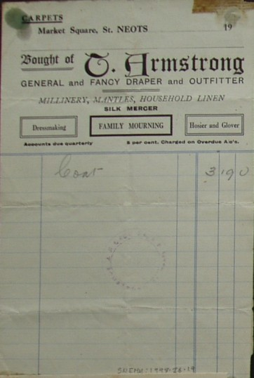 Invoice for a coat from T. Armstrong, outfitter and drapers, Market Square, St Neots, dated 1930
