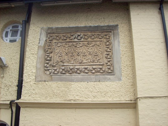 Mediaeval plaster moulding on the side of the Bridge Hotel in St Neots