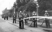 Fire Hose practice by the St Neots Firemen in Church Street St Neots, in the 1930s