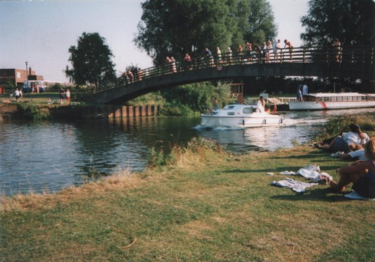 Pre fab Coneygeare Bridge across River Great Ouse, Eynesbury, Working Mens Club and Popeye's boat Restaurant, around 1980
