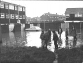 Children playing in the floodwater in the early 1980s in Oak Close, St Neots