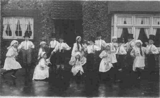 School children in dance costume at Eynesbury School outside the School House, about 1905