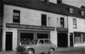 Frontage of Tebbutts Builders Merchants at 45 High Street, St Neots, in 1955