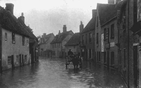 Flooding in St Marys Street, Eynesbury from near the bridge looking south, 1900-1920