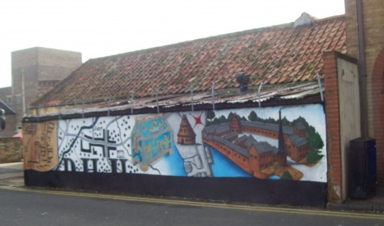 Mural of St Neots Priory painted in Priory Lane, near the Waitrose Car Park in St Neots in October 2008