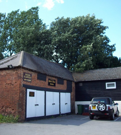 Garages in the car park at the White Horse Inn on the Great North Rd, Eaton Socon in August 2011
