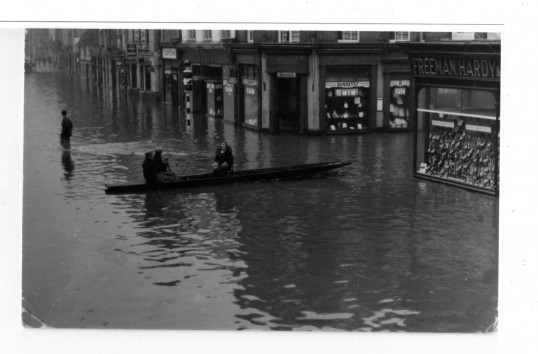Floods in St Neots High Street in 1947 at Barrett's corner