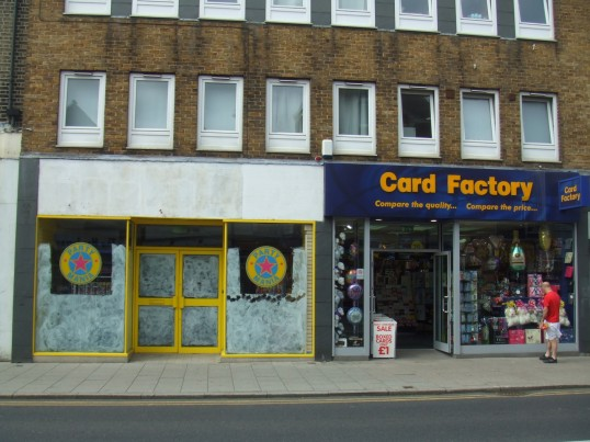 Party Mania (about to open) and Card Factory in St Neots High Street, in July 2010