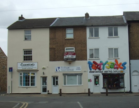 Essentials Beauty and Hair Salon, Trillium Offices and Party Jacks Shop in New Street, St Neots, in July 2010