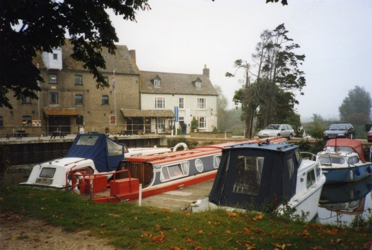 Boats on the River Great Ouse in front of Eaton Socon Rivermill in October 1994