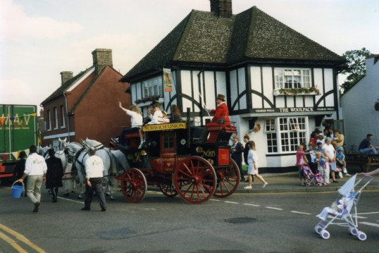 Norwich Union Coach in the 1993 St Neots Carnival Procession outside the Woolpack Public House in Church Street