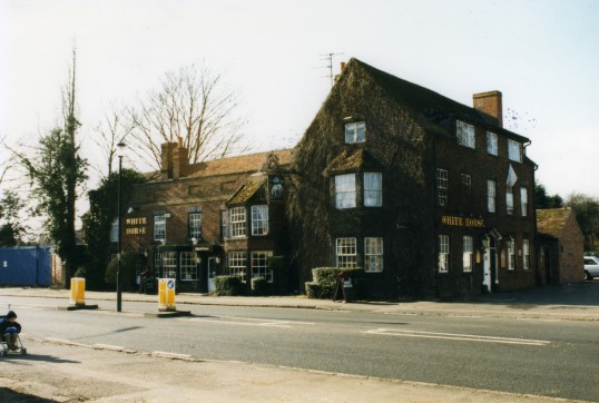 White Horse Public House in 1999 in Eaton Socon with blue boarding to the south where Roberts Close was being built.