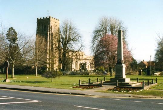 Eaton Socon War Memorial and Eaton Socon Church looking across Eaton Socon Village Green in February 1999