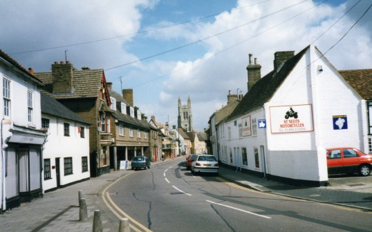 St Marys Street, Eynesbury, with St Neots Motorcycles on the right (former bakers and grocers) and shops on the left in July 1998