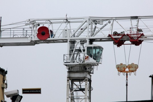 Giant poppy on  a crane at Laing O'Rourke site near the A428 at St Neots in November 2010