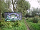 Large fish mural along the river bank, south of Eaton Socon Lock, Eynesbury (P.Ibbett)