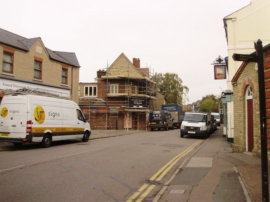 The last letters being put on the building for 'The Weeping Ash' (former Post Office) in New Street, St Neots in October 2010 (P.Ibbett)