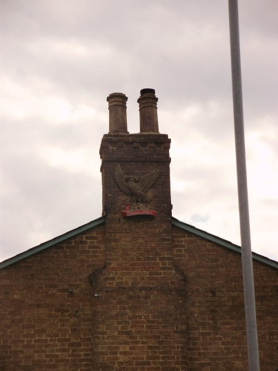 Charles Wells eagle on the side of the Eaton Oak chimney in Eaton Ford in August 2010 (P.Ibbett)