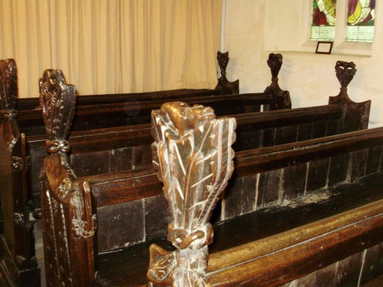 Eynesbury Church, St Marys - one of the carved pew ends, in August 2009 - part of the Eynesbury Zoo (P.Ibbett)