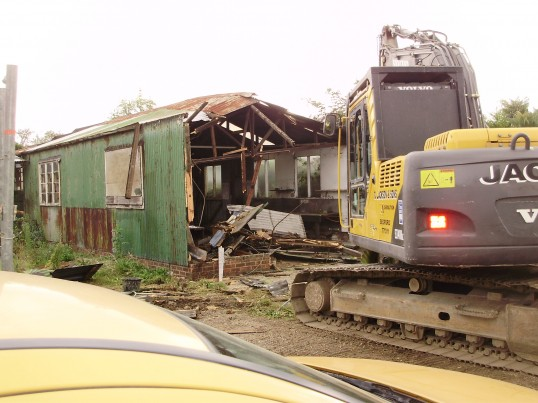 Perry and Saunders Garage just off Mill Hill Rd , Eaton Ford being demolished in September 2009 (P.Ibbett)